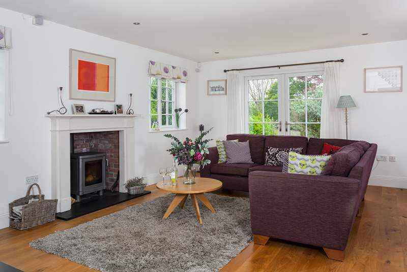 The open plan living-room is a sociable place to relax in and has a wood burner if the evenings happen to get a little chilly.