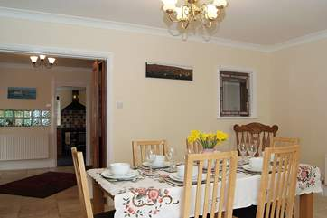The dining-room with the hall and kitchen in the background.