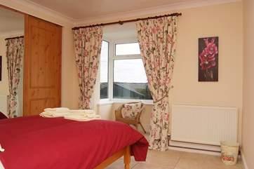 The ground floor double bedroom (Bedroom 1).