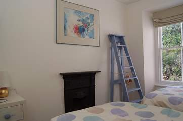 The twin bedroom with its innovative step ladder storage-area.
