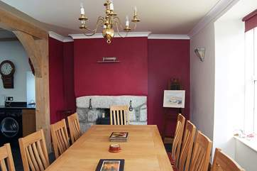The dining-area, with plenty of room for everyone at the table, has a wood-burner at one end.