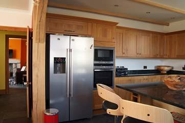 The kitchen is equipped with all you may need - including an extra large fridge!