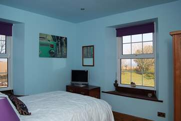 Bedroom 1 also has a television, and wonderful views from both windows.