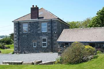 The front of the house is painted, but the rest displays the granite blocks with which it was originally built including the annexe (on the right).
