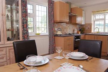 The kitchen/dining-room is lovely and bright with windows on three sides.