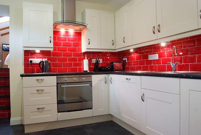 The stylish kitchen is fully equipped and provides all you require for self-catering.