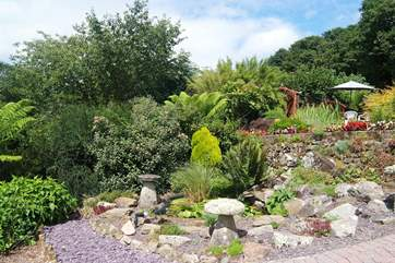 Part of the Owners' beautiful garden which is immaculately maintained.