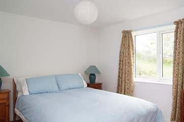 Bedroom 1 is furnished with a king-size double bed.
