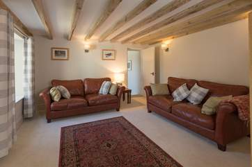 The sitting room has comfortable leather sofas and is a very tranquil room to relax in at the end of a day out on Exmoor.