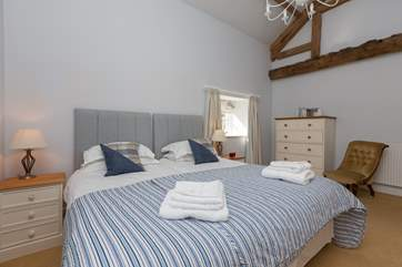 This bedroom is exceptionally spacious and beautifully presented.