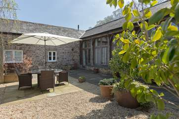 The courtyard seating area captures the sunshine for most of the day and has been made to feel  very private and sheltered with attractive planting.