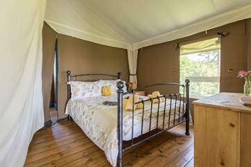 The pretty double bedroom is at the back of the tent.