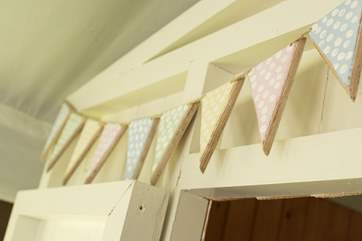 The pretty hand-made bunting.