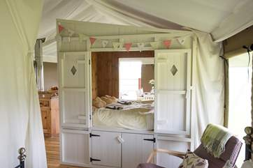 The cute cabin bed.