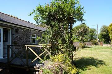 Trip trap over the bridge to the beautiful enclosed garden (please take care there is no barrier between the stream and the garden).