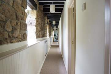 The hallway runs past the bedrooms to the sitting-room.