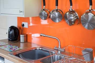 The kitchen splashed with colour.