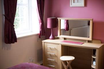 The dressing area in bedroom 2.