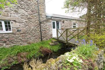 The bridge leads from the sitting-room to the garden.
