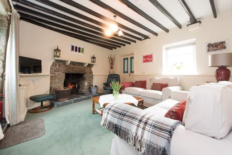 The sitting-room has a roaring wood-burner.