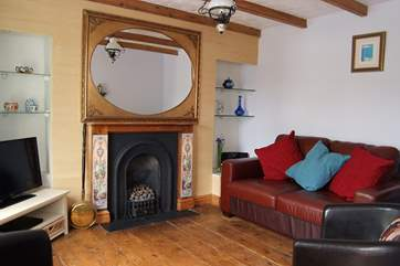 The sitting-room includes a living-flame gas fire set into the original fireplace.