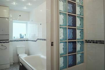 The bathroom includes a double shower cubicle as well as a bath.