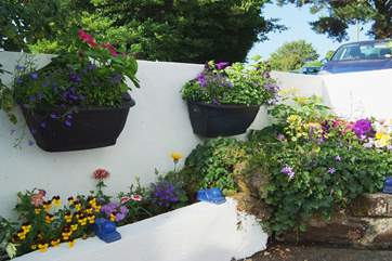 Every available corner is beautifully planted with colourful flowers.