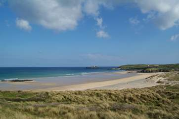 Miles of golden sands stretch between Hayle beach and Godrevy lighthouse at the far end of St Ives Bay.