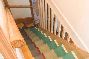The cottage staircase has been imaginatively and colourfully painted.
