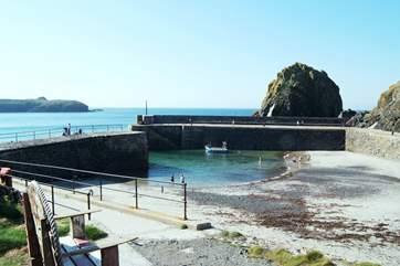 The picturesque harbour has a sandy beach at low tide.
