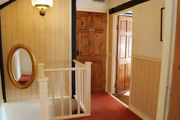 At the top of the stairs the large landing leads to the bathroom and bedrooms.