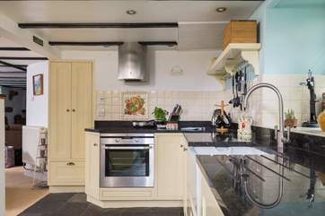 Granite worktops and a Butler sink add to the appeal of this stylish kitchen.