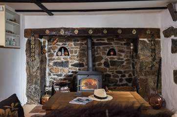 The multi-burner in the old stone fireplace is ideal for out-of-season breaks.