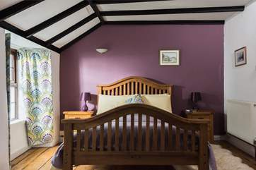 The master bedroom is furnished with a king-size 5' double bed.