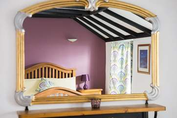 Clever cloth shutters are not only decorative but also keep out the light first thing in the morning.