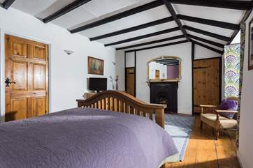 The double bedroom is unexpectedly spacious and retains many original features.