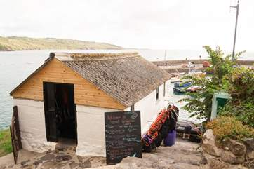 The windsurfing school where you can hire a kayak, paddleboard/SUP or take a windsurfing lesson (April to September).