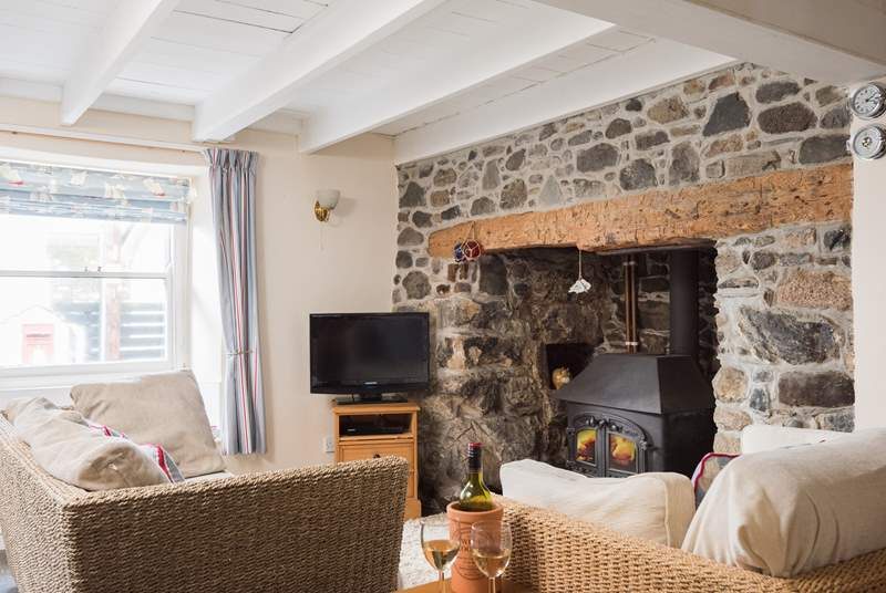 The sitting-area, at the front of the cottage with cosy wood-burner, leads through to the dining-area.