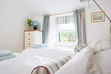The pretty twin room is at the back of the cottage.