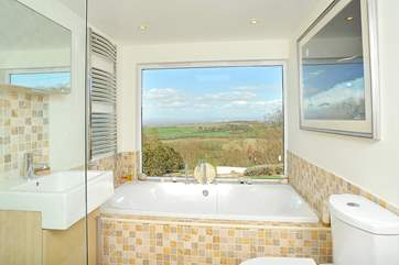 This is the stunning en suite bathroom for Bedroom 1 - not many places where you can sit in the bath and look out across the Bristol Channel!