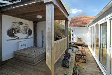 Bedroom 2 opens out onto this little courtyard with the Japanese cedar bath - a very special bonus!
