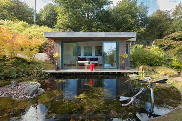 The stunning Japanese-style summer-house is at the lower end of this beautiful garden.
