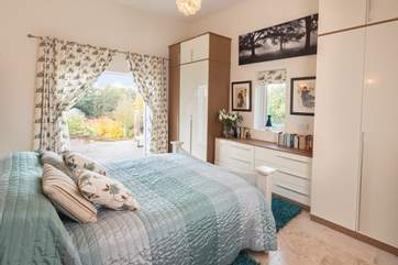 This is the bedroom suite on the lower ground floor - more doors to the garden too.