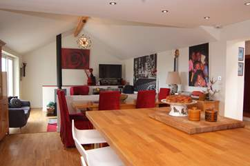 There is a really spacious open plan layout here with a large island as well as the dining-table.