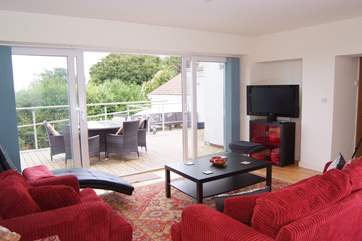 As well as the open plan living area there is this lovely second sitting room opening out onto the terrace.