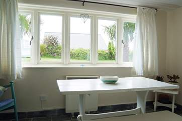 The garden-room is a lovely little space offering views out across the garden.
