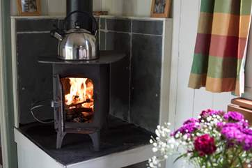 The little wood-burner will keep you very cosy and warm on cooler days.
