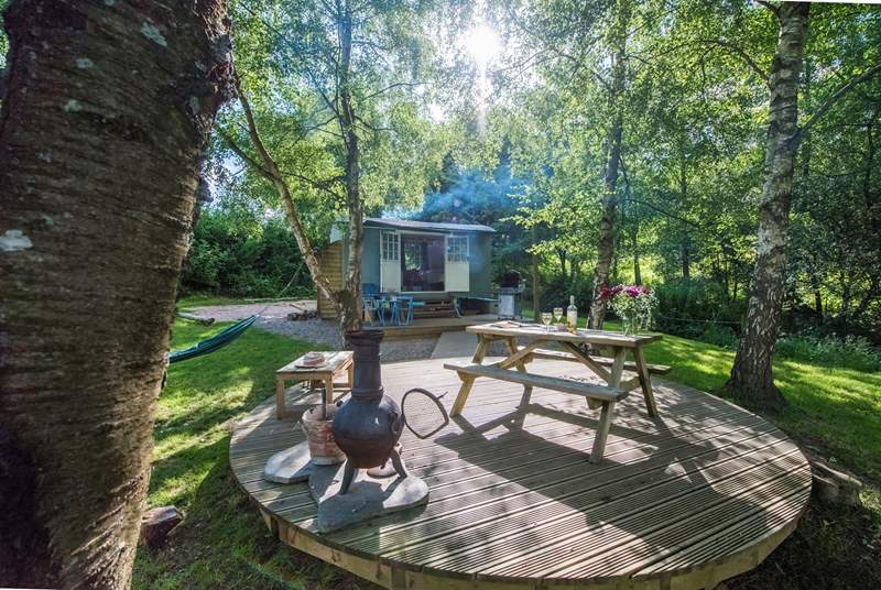 There is a large lakeside decking-area with a barbecue, chiminea and picnic table in front of the hut.