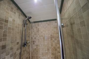 The en suite shower-room with shower and proper flushing toilet.