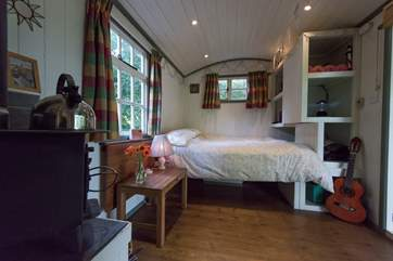 A comfortable double bed is tucked into one end of the shepherd's hut - the en suite is at the other end.